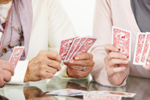 Hands_playing_cards